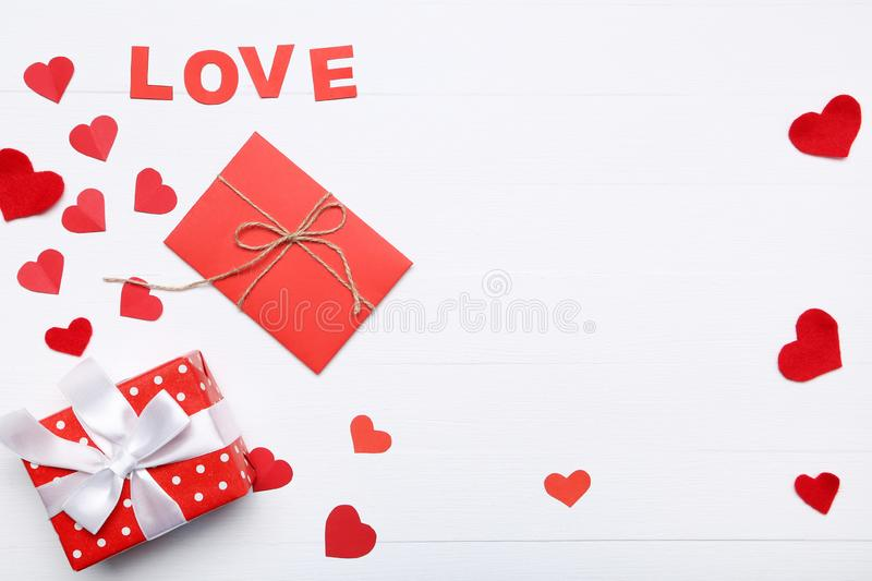 Hearts with word Love and gift box royalty free stock images