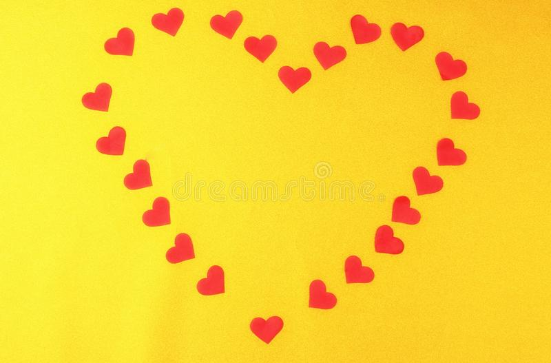 Red hearts on yellow golden background. Valentines day concept flat lay royalty free stock photos