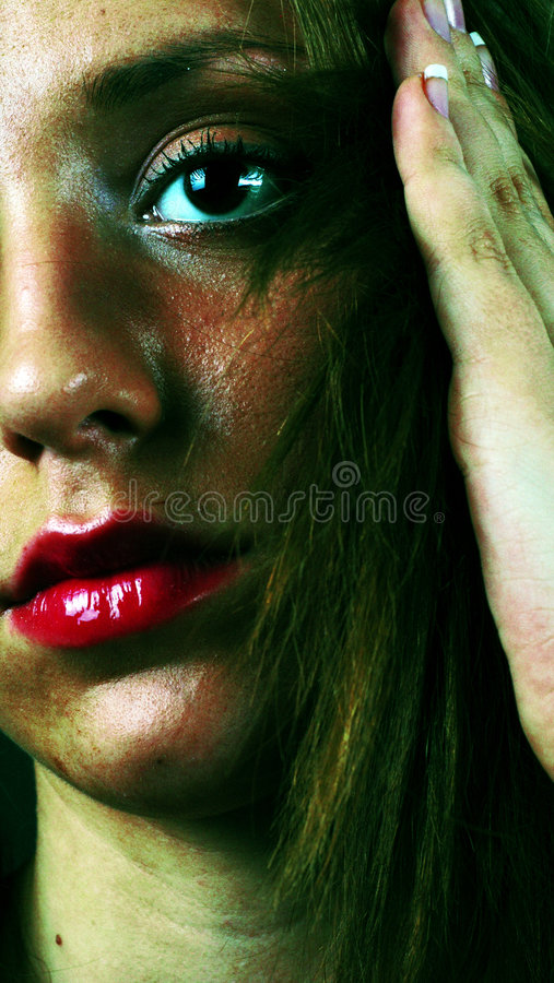 Red heat. Portrait of a beautiful girl in high contrast colors, exuding heat and intense emotions stock images