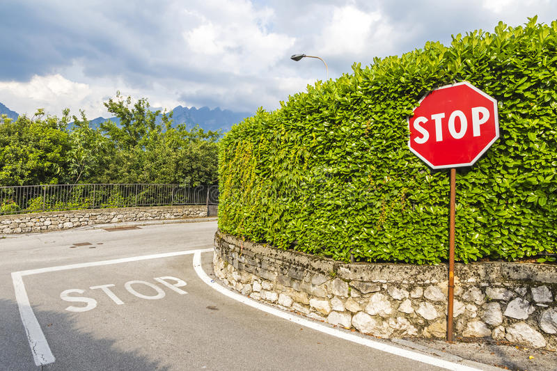 Red hexagonal stop sign on metal pole royalty free stock images