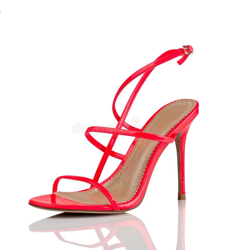 Red high heel shoe. Beatiful woman red high heel shoe on white background stock image