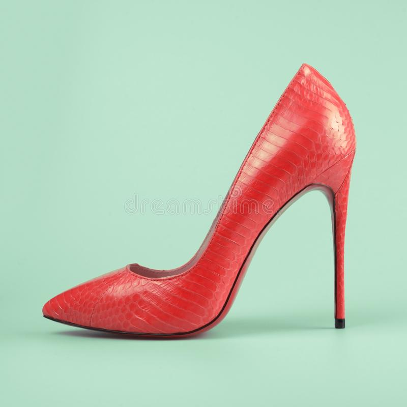 Red high heel shoes. Over blue stock photography