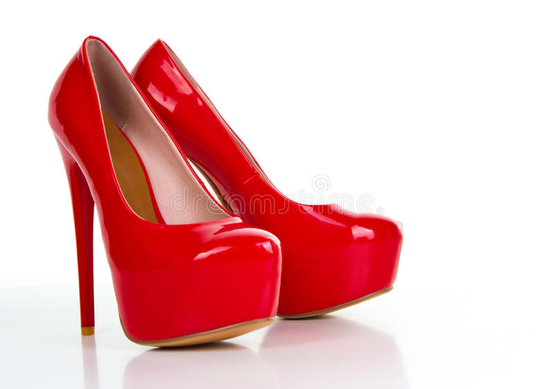 Red high heel women shoe. Isolated on white background stock images