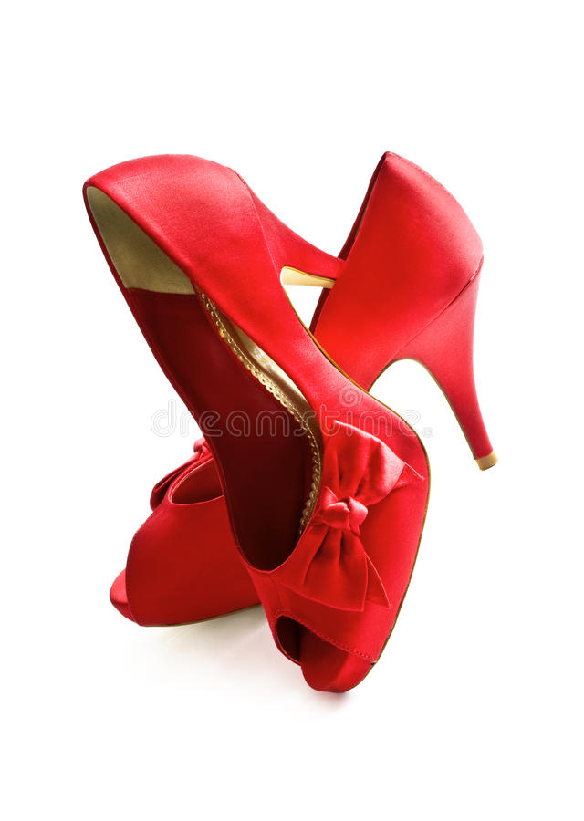 Red High Heels Shoes. Shiny red fashion high heels shoes on white background royalty free stock photo