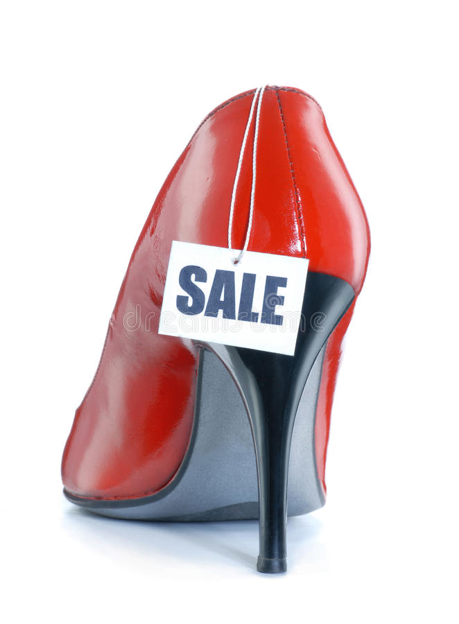 Red shoe sale. Red high heels shoes on sale,High heels shoes with sale bill royalty free stock photos