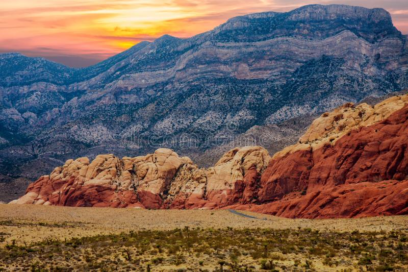 Red Hills Between Desert and Purple Mountains stock photos
