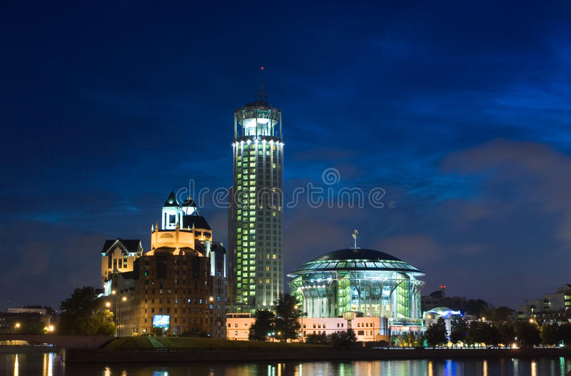 Red Hills Swissotel hotel and Hous of Music. View of the Red Hills Swissotel hotel and Moscow International Hous of Music over the Moskva-river at night royalty free stock photos