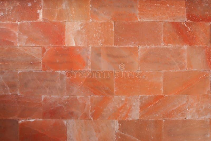 Red himalaya salt bricks wall texture Wallpaper background stock image