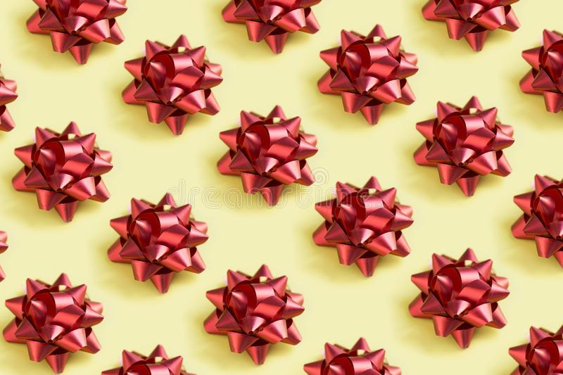 Holiday bow pattern. Red holiday bow pattern on yellow background stock images