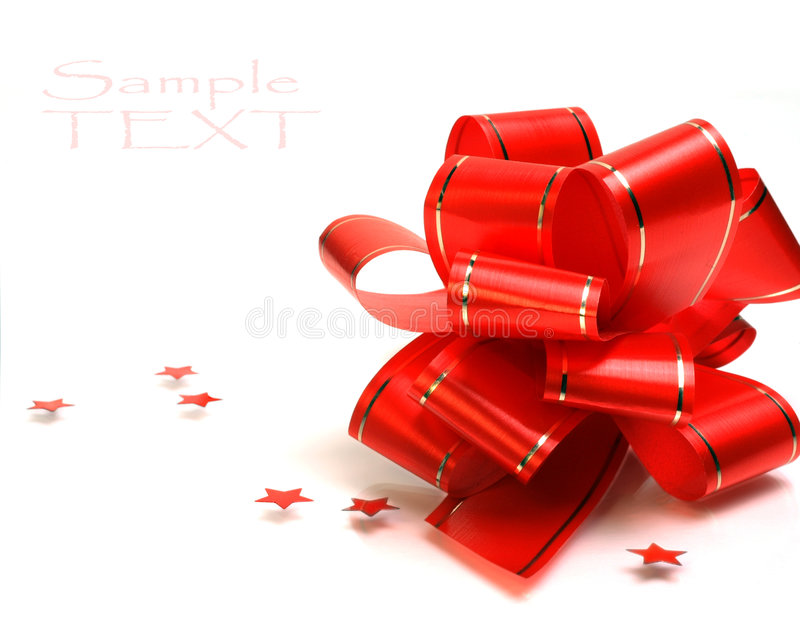 Red holiday bow on the white background stock photo