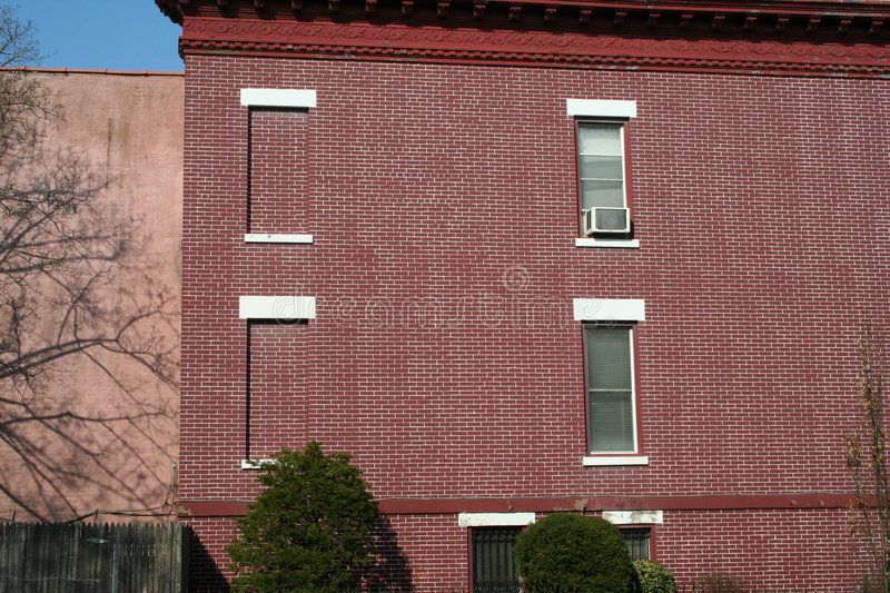 Red home in New York. Brick homes of Brooklyn (New York) , United States of America royalty free stock photo