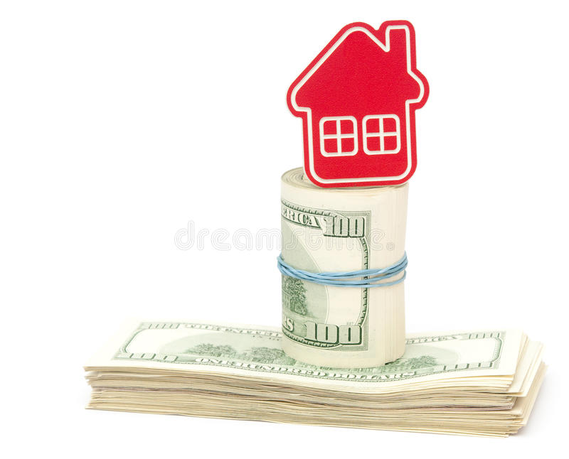 Red home sign. On hundred dollar bills. Real Estate business Concept stock photo