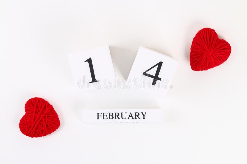 Red homemade diy heart made cardboard, yarn, wooden perpetual calendar on white background. Idea St. Valentines Day, day love, stock image