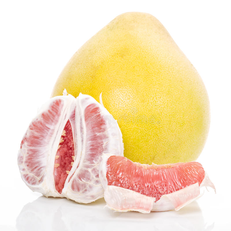 Red honey pomelo. The red honey pomelo in white background stock images