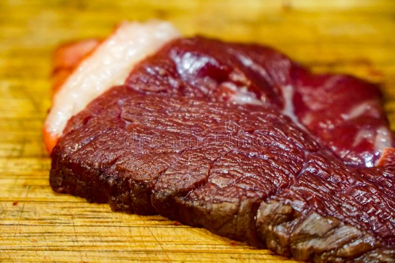 Red horse meat on wooden cutting royalty free stock images