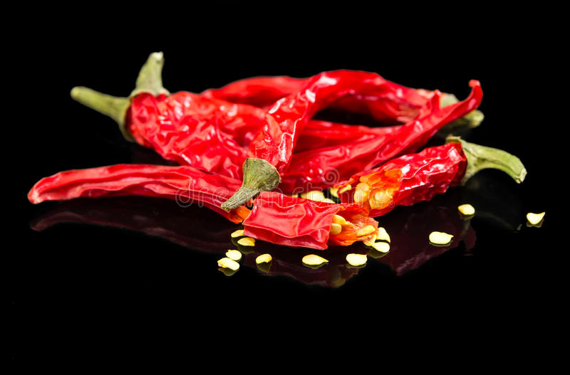 Red hot chili pepper black on black background stock photos