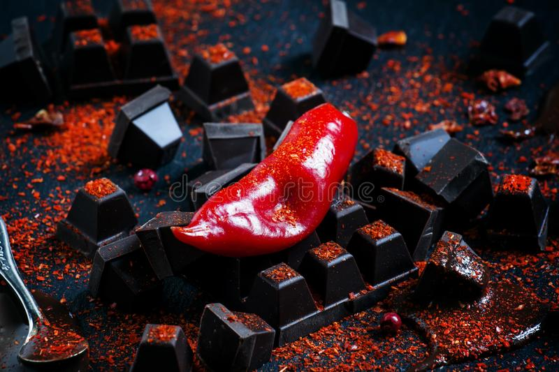 Red hot chili pepper, dark chocolate pieces, chocolate sauce, gr stock images