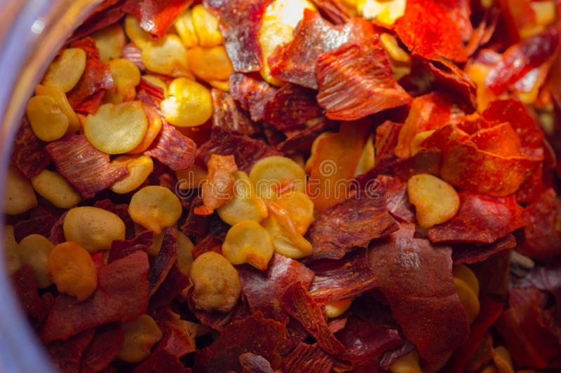 Red chili flakes in a glass jar royalty free stock photo