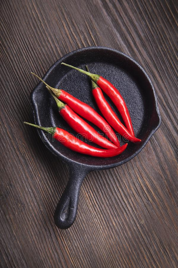 Download Red Hot Chili Pepper In Pan On Wood Background Stock Image - Image of wooden, photography: 119489753