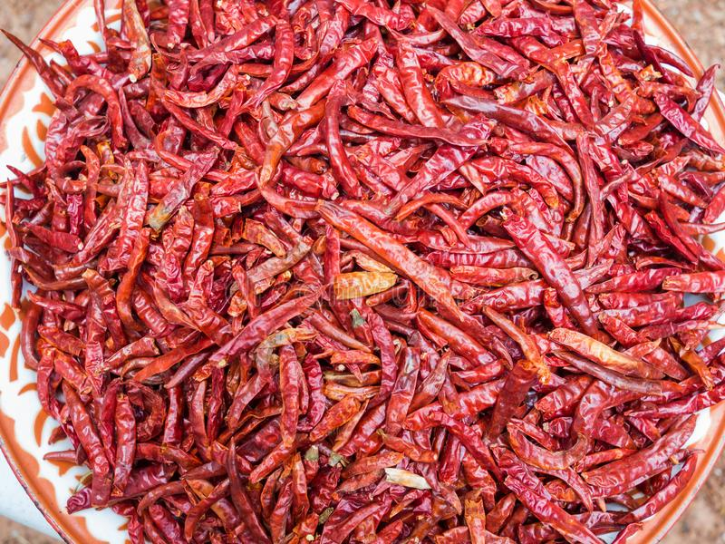 Red hot chili peppers. Huge bowl with many dried red hot chili peppers stock image