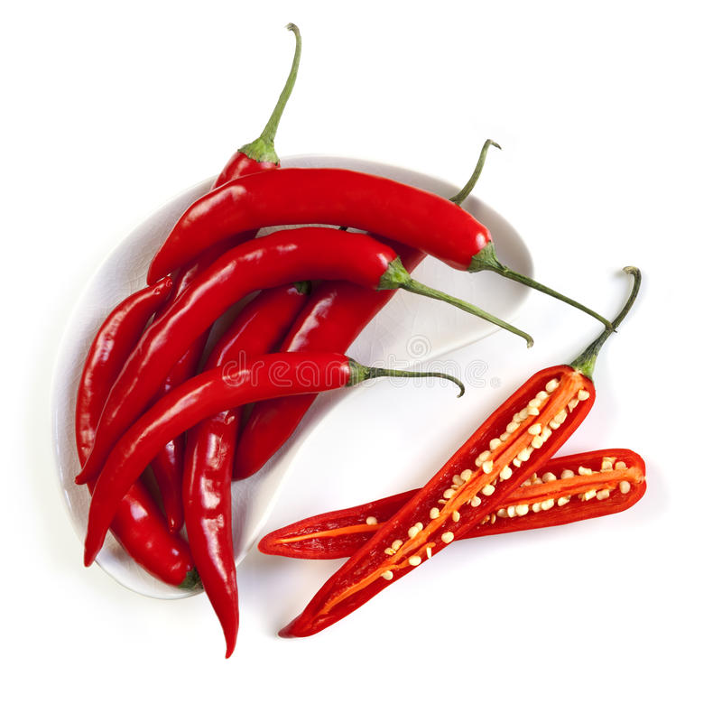 Red Hot Chili Peppers. Whole and cut, isolated on white. Overhead view royalty free stock photography