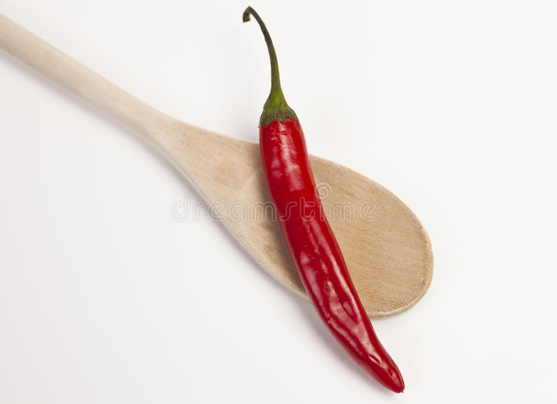 Red hot Chili with wooden Spoon