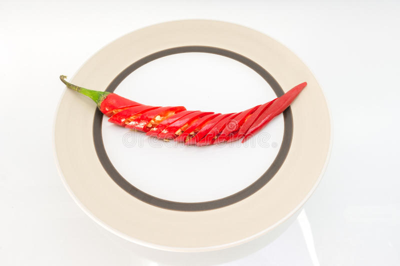 Red hot chilli peppers. Red chilli slice on the plate,thai peppers stock photos