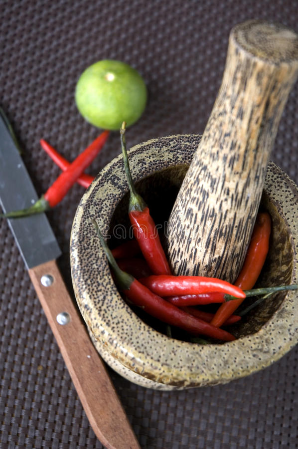 Red hot chilli in wooden mortar stock photos