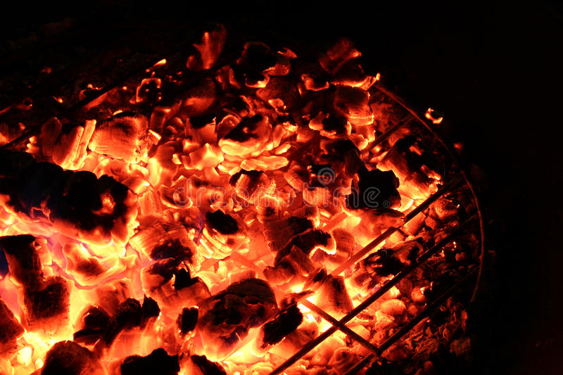 Red Hot Coals in a Campfire royalty free stock images