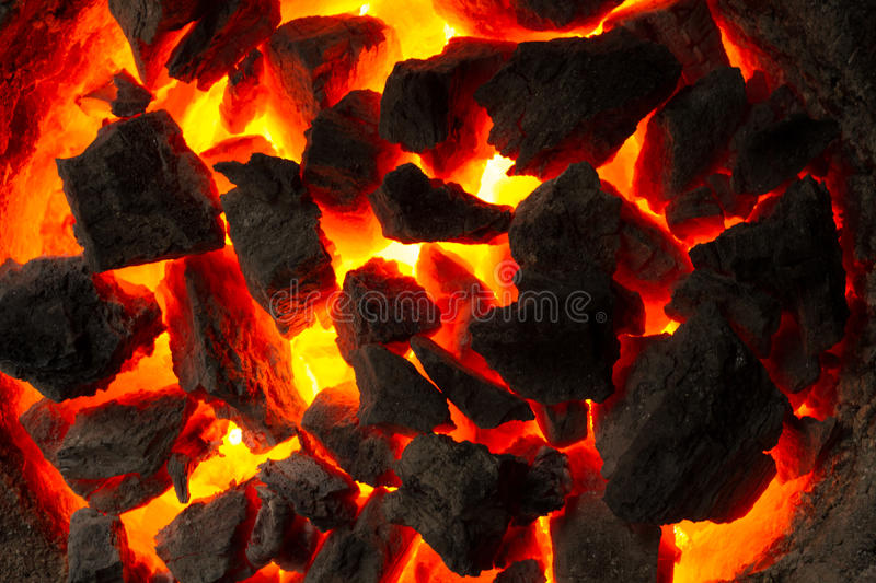Red-hot coals. Texture fire. Texture coals. Oven for cooking cakes. Indian Oven stock image