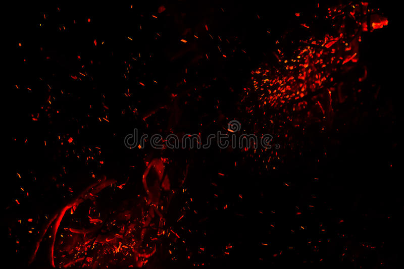 Red hot sparks on a black background royalty free stock image