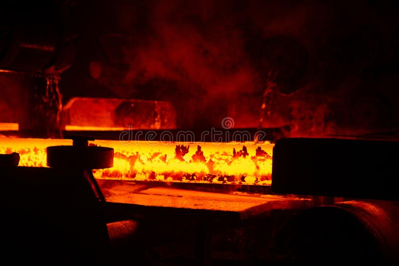 Red hot steel metal billets after molten steel casting. Background of the blacksmith and metallurgical industry.  stock photo