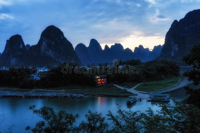 Red hotel by li river. A small red hotel by the li river lit up at night by the lanterns. Taken near laozhai mountain in Xingping, Guangxi province, China royalty free stock photography