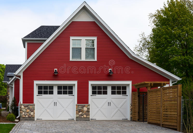 Red house with a double garage stock images