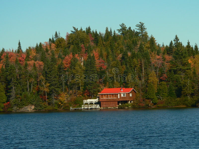 Red house on the lake shore stock photography