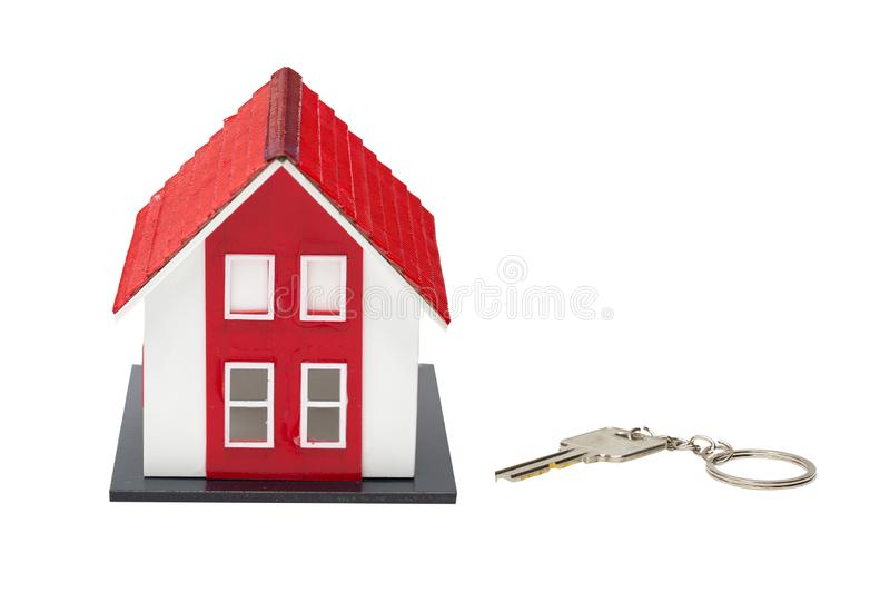 Red house model and house key isolated on white background stock photo
