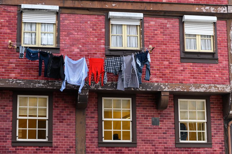 Red house in Porto with laundry. Hanging outside to dry royalty free stock photo