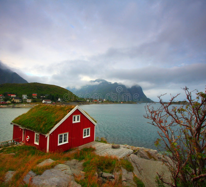 Red house and sea royalty free stock photography
