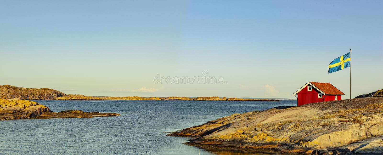 Red house in Sweden at the skerry coast stock photos