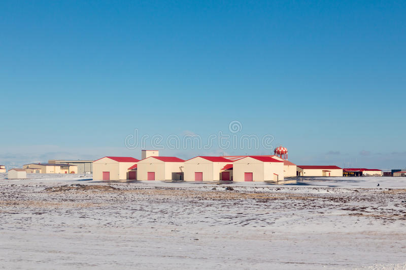 Red Hut over snow ground with clear blue sky background, Iceland stock photo
