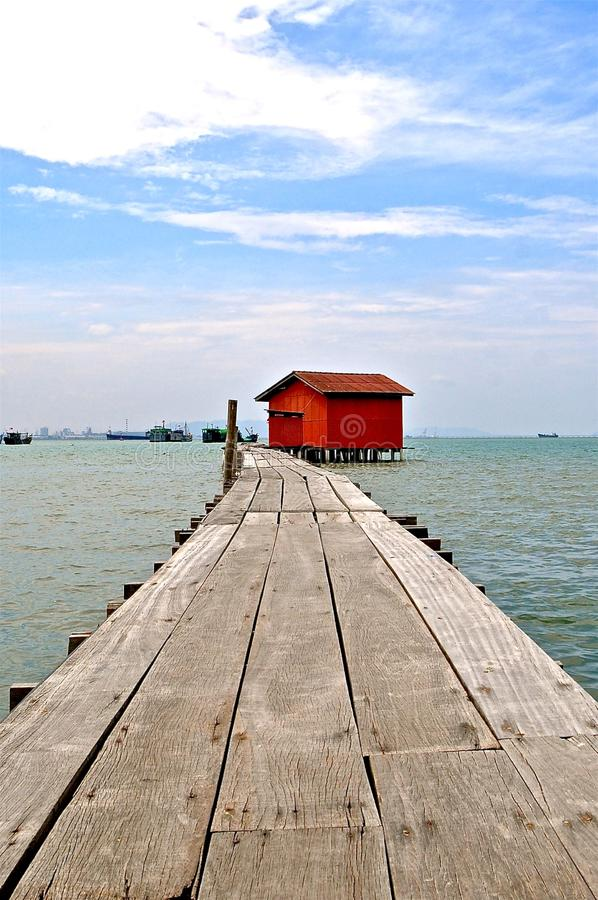 Red hut on a jetty royalty free stock image