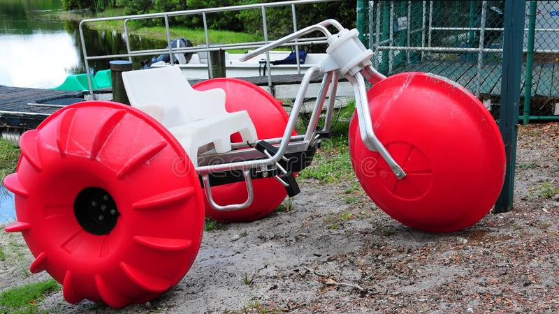 Red hydrocycle. Pedalo or paddle boat in a South Florida park stock images