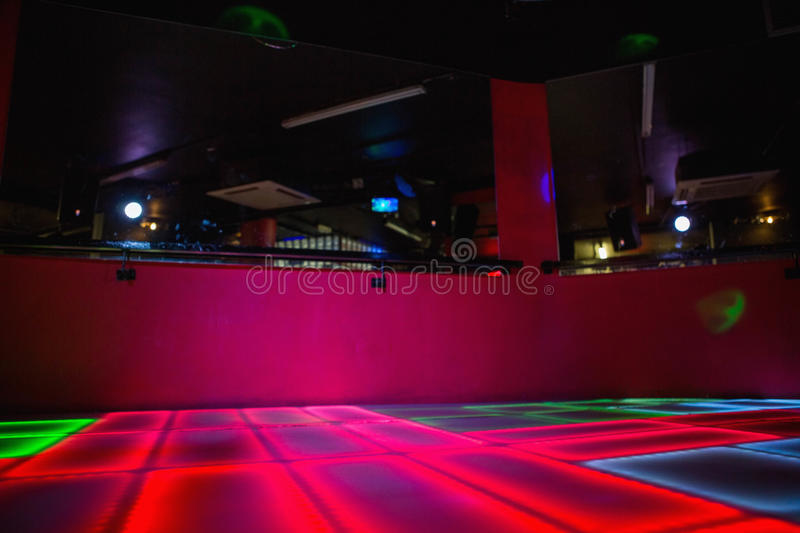Red illuminated disco dance floor stock images