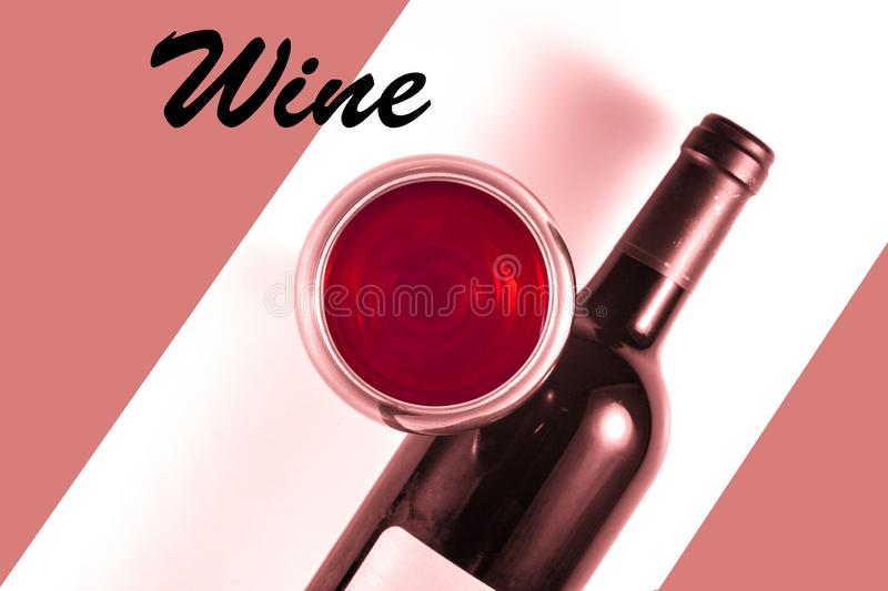 Bottle and glass of red wine. Red image of a bottle and glass with red wine and the words `Wine stock photography