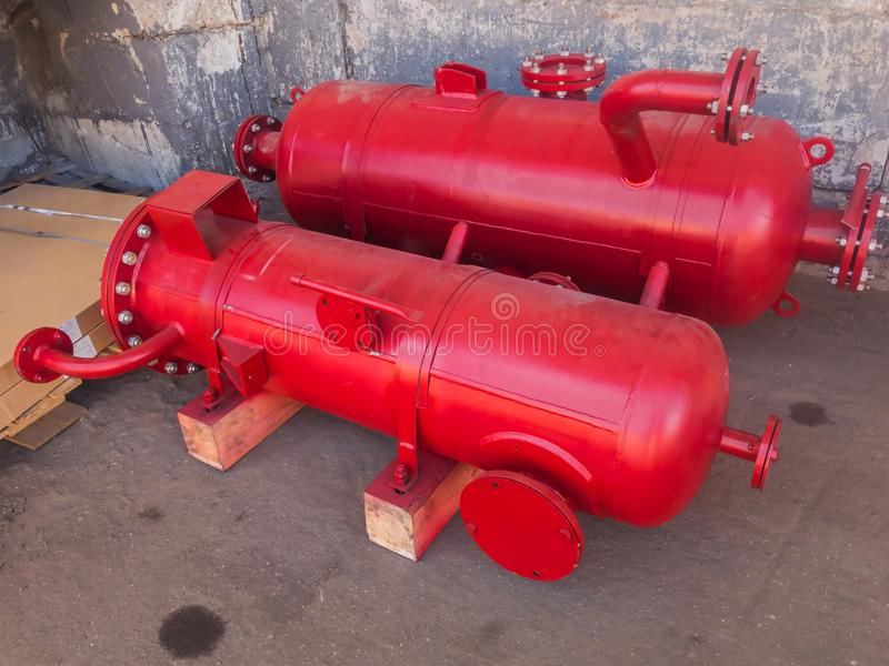 Red Industrial heat exchangers, tube shell and tube high efficiency. stock photos
