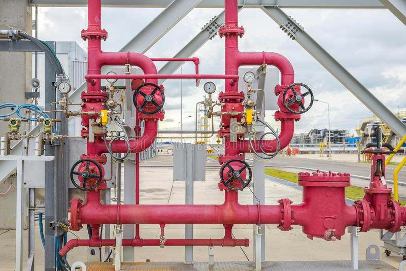 Red industrial valves. Pipeline valves for industrial purposes royalty free stock photo