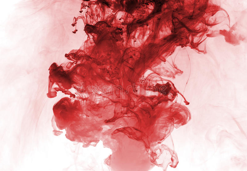 Red ink in water. royalty free stock image