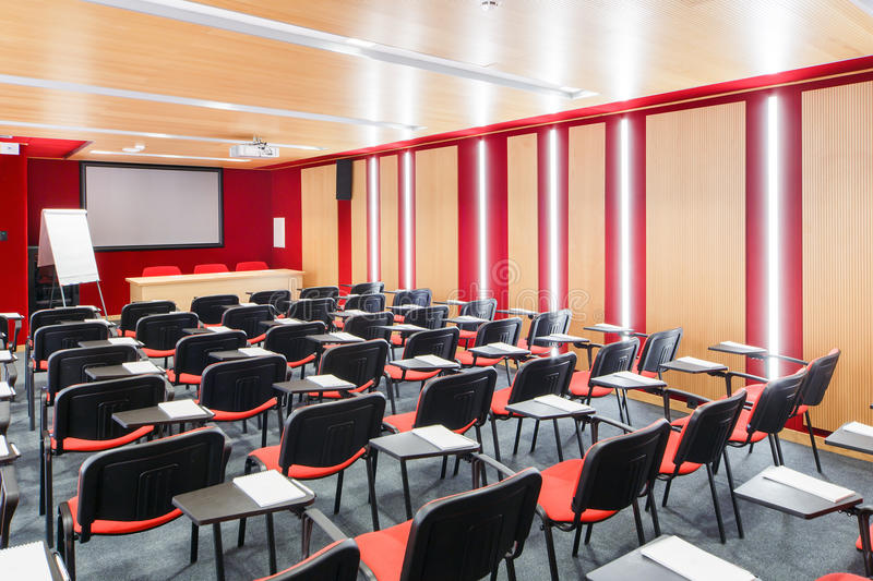 Red interior conference halls with flipchart, overhead projector royalty free stock photography