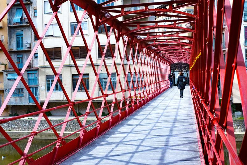 Red iron bridge - Eiffel bridge across river Onyar in Girona, Catalonia royalty free stock images