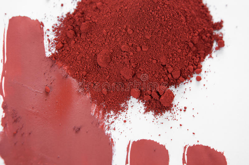 Red iron oxide pigment. Red ochre, also spelled ocher, a natural red earth pigment based on hydrated iron oxide stock images